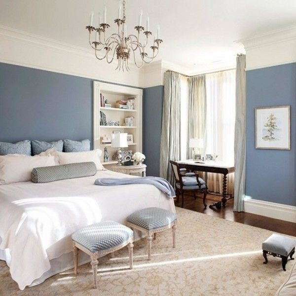 Bedroom Colour Scheme: Light Blue Walls Cushions and Details Contrast with Beige and White Ceiling, Rug, Bed, and Bookshelf