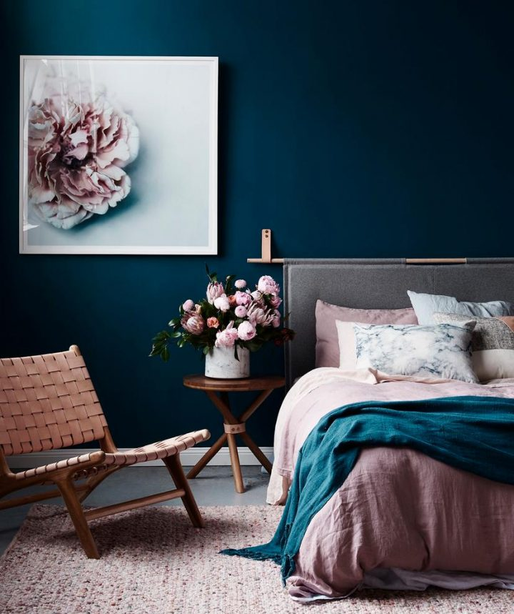 Bedroom Colour Scheme: Dark Blue Walls Contrast with the Light Pastel Rosé Hues of Furniture and Bedlinen