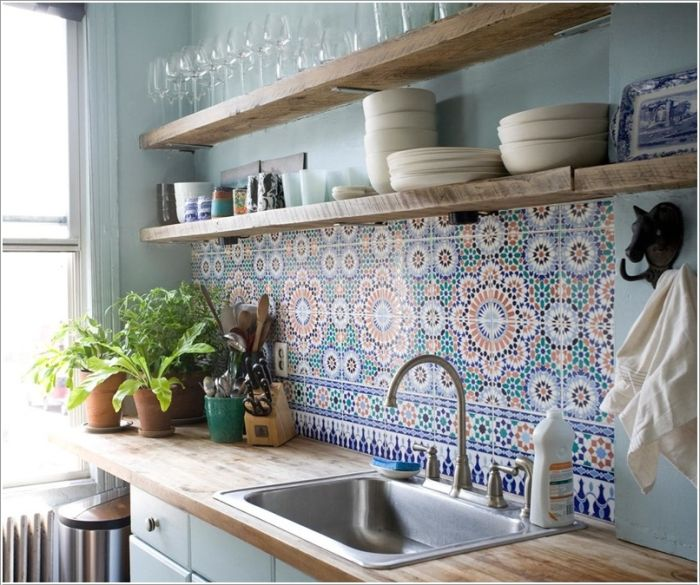 Mosaic Tiles in Greens, Blues and Reds on the Wall Crate an Oriental Atmosphere