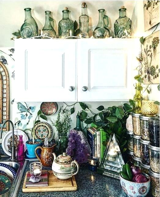 It's the Details that Make Up a Bohemian Kitchen - Jars with Herbs and Grains, Old Books, Candles, Decorative Bottles, Plates and a Tea Set