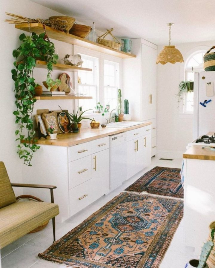 White and Golden Wood Modern Kitchen turned into Bohemian Chic by Utilising Two Patterned Oriental Rugs and Various Knick Knack on the Shelves