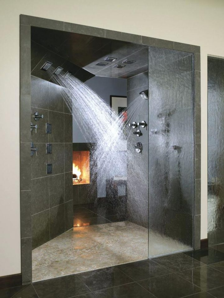 Doorless Shower with Fireplace in the Background