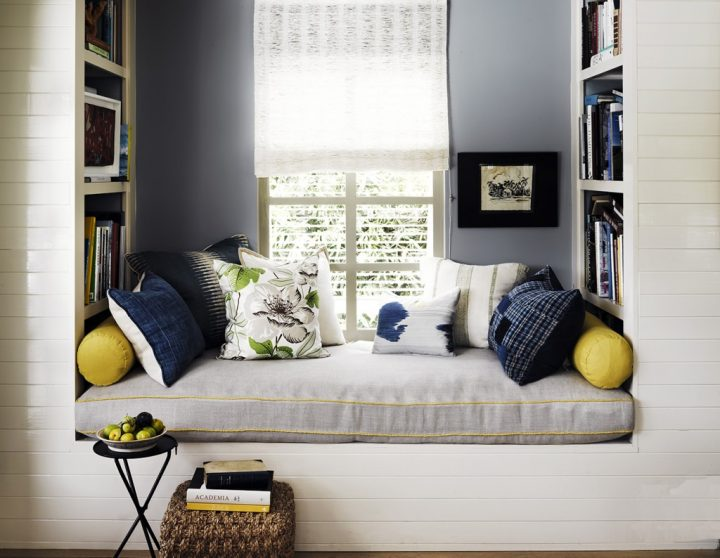 Reading Nook Framed by Shelves in Dormer Window