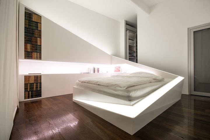 Futuristic Bedroom Idea: Bed Built into a Rectangular, Room Divider-Like Wall Wrapping Around it