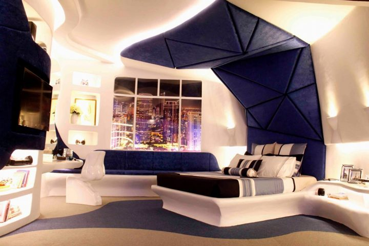 Futuristic Bedroom Idea: Bed Located under a Geometic Blue Leather Canopy