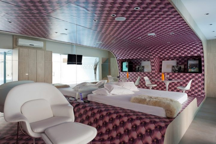 Futuristic Bedroom Idea: Pink And Black Checkered Pattern Wraps Around Floor, Wall, and Ceiling Wrapping the Bed in a Riot of Colour