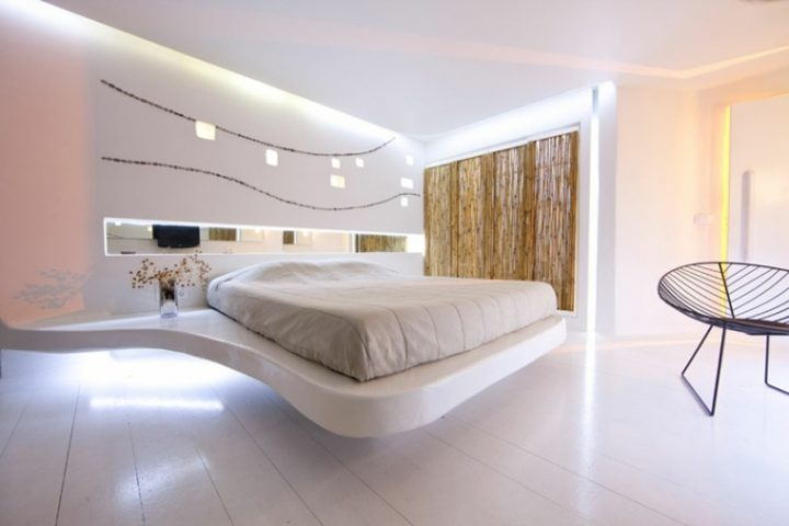 Futuristic Bedroom Idea: Floating Bed on a White Platform that Widens to Form a Nightstand