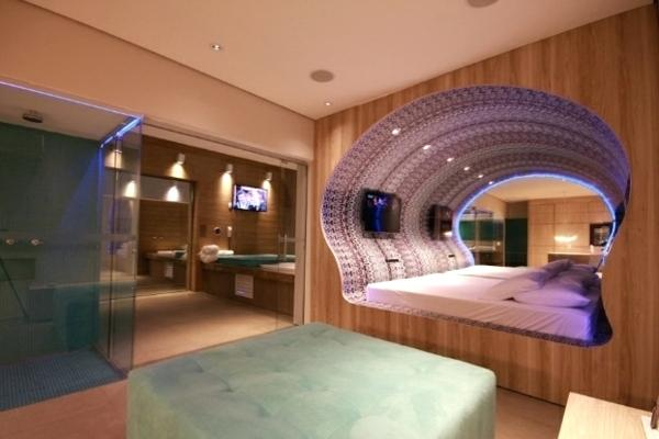 Futuristic Bedroom Idea: Bed Located in a Pod-Like Circular Hole in the Wall
