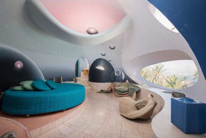 Futuristic Bedroom Idea: Room With Curved Walls and Similarly Curved Furniture with Round Windows, a Circular Bed and Bubble Design Elements