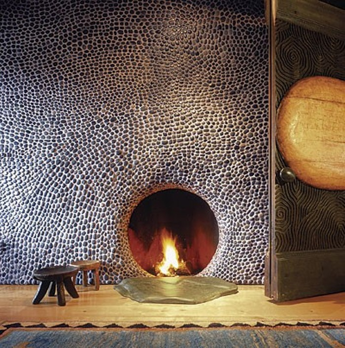 Round Fireplace with River Rocks