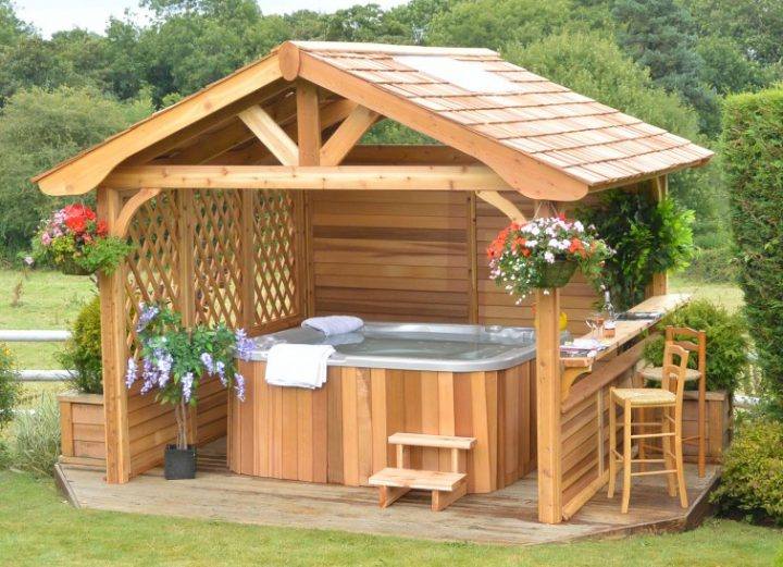 Hot Tub In Semi-Enclosed Gazebo that Features Bar Seating At one Side of the Building