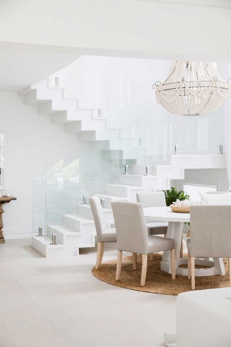 Virtually Invisible Glass Panel Railing in White Living-Room