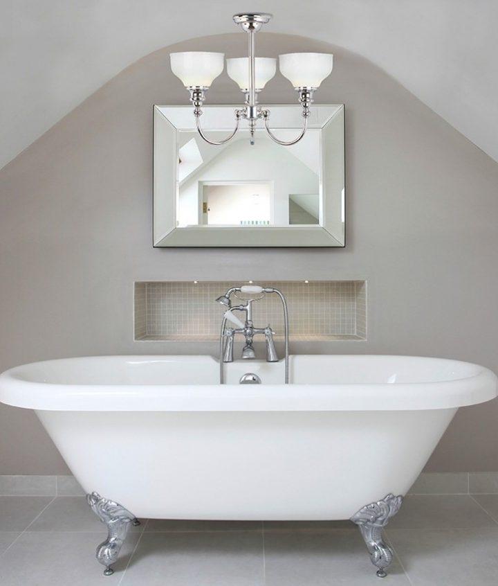 Minimalist Master Bathroom with Chandelier Over Bathtub