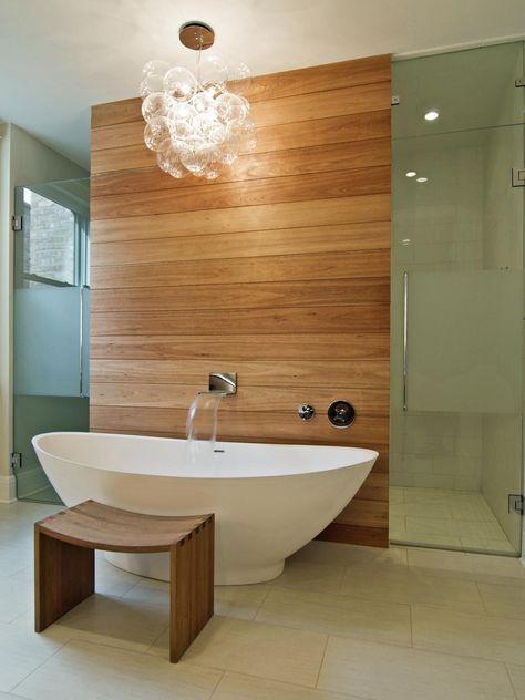 Master Bathroom With Modern Chandelier Over Tub