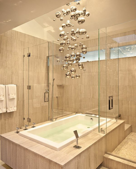 Minimalist Master Bathroom With Walk-In-Shower and Bathtub Combo and a Modern Chandelier With Bronze Ball Pendants of Varying Sizes