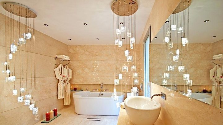 Reduced, Clean-Lines Master Bathroom with Two Extravagant Modern Chandeliers