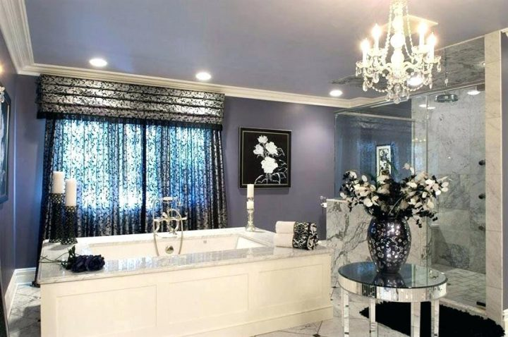 Opulent Master Bathroom Done In Greys and Blacks with Smallish White Chandelier as Accent Lighting