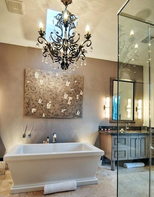 Master Bathroom With Brushed Steel and Glass Chandelier