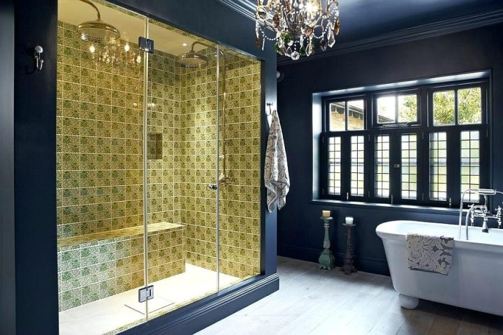 Dark-blue Master Bathroom With Crystal Chandelier in Middle of the Room