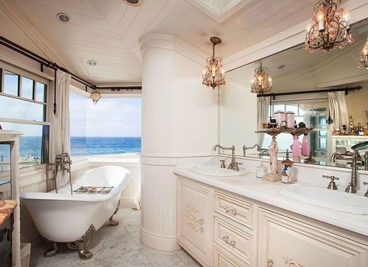 Traditional Master Bathroom With Sea View and Small Chandeliers Mounted over the Sinks