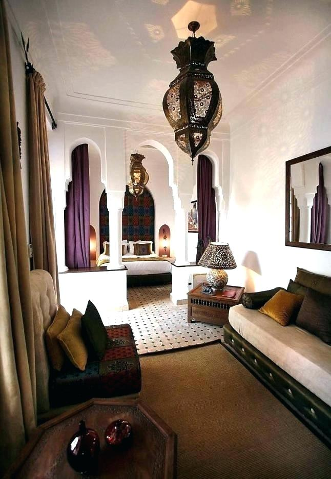 Moroccan Bedroom Decor: Bed Separated From Rest of the Room via Columns and Arches