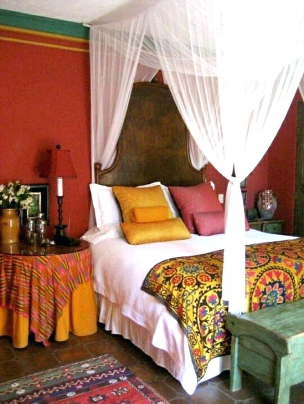 Moroccan Bedroom Decor: White Sheer Curtain Affixed to Ceiling in Style of Four Poster Bed