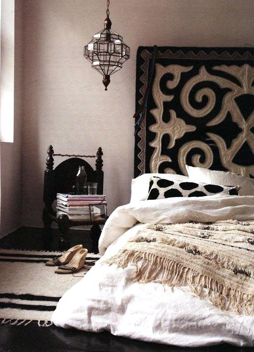 Moroccan Bedroom Decor: Woven Carpet, Knit Throw and Patterned Wall Blanket in Monochromes