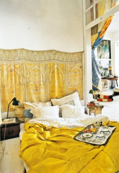 Moroccan Bedroom Decor: Saffron Yellow Fabric Hung From Wall