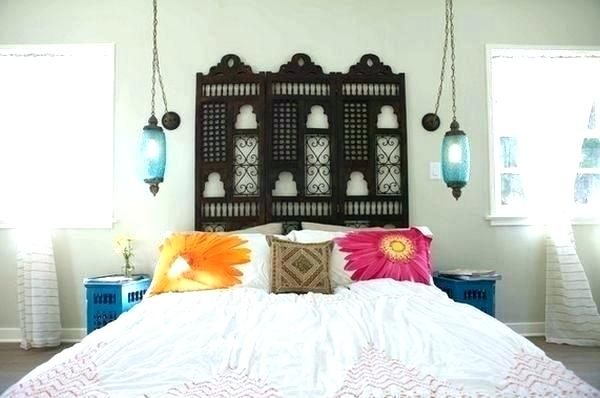 Moroccan Bedroom Decor: Ornately Carved Dark Wooden Headboard