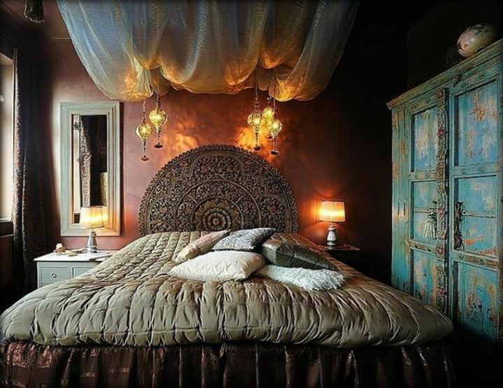 Moroccan Bedroom Decor: Dark Bedroom With Beautiful Circular Headboard Made from Carved Wood