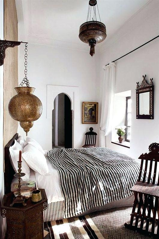 Moroccan Bedroom Decor: Lanterns Suspended from Wall and Ceiling