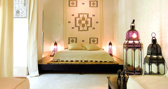 Moroccan Bedroom Decor: Room Lit By Four Traditional Lanterns Sitting on the Floor