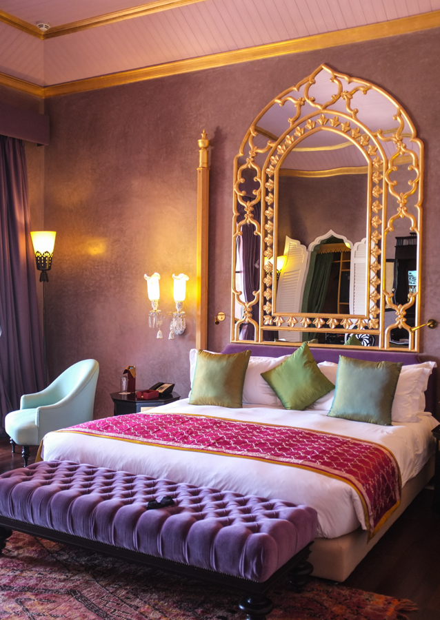 Moroccan Bedroom Decor: Mirror with Beautiful Golden Design Elements Set Onto the Glass