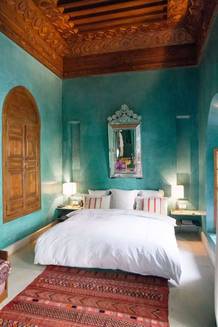 Moroccan Bedroom Decor: Heavy, Silver-Framed Mirror Over Head of Bed
