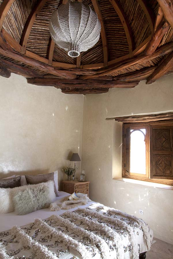 Moroccan Bedroom Decor: Partially Opened Wooden Window Shutters