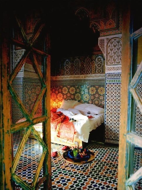 Moroccan Bedroom Decor: Colourful Geometrically Patterned Tiles on Floor and Ceiling