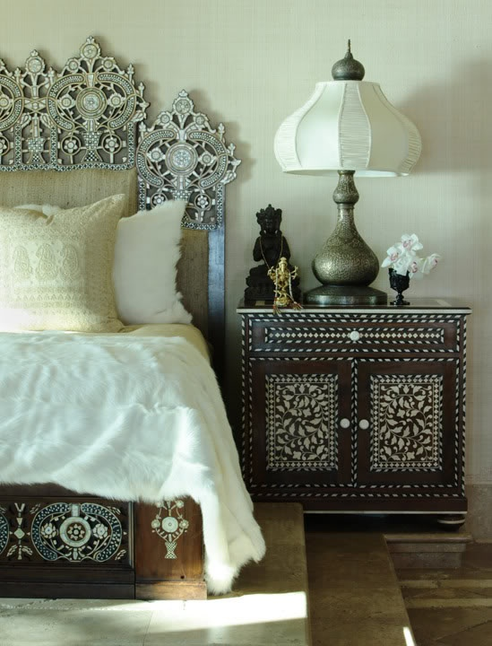 Moroccan Bedroom Decor: Dark Wood Nightstand and Bed with White Decorations