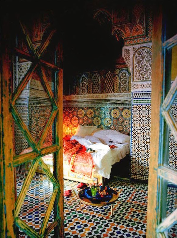 Moroccan Themed Bedroom With Colourful Tiled Floor and Walls in Different Geometrical Patterns