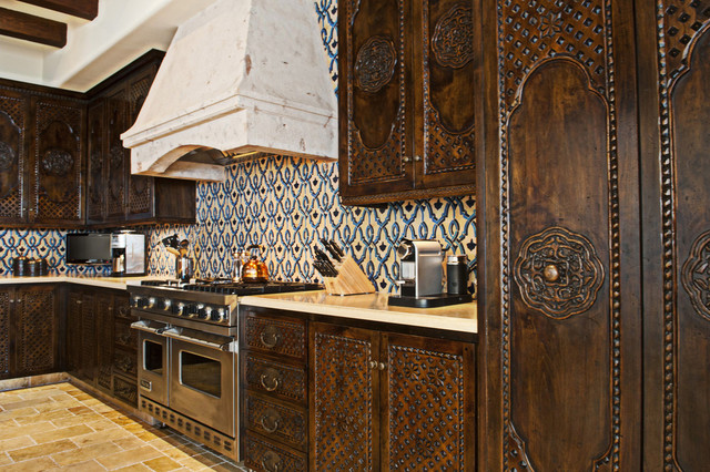 Moroccan Themed Kitchen with Dark Wood Furniture and Patterned Tiles