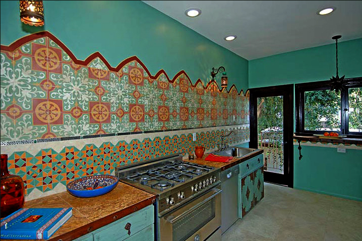 Colourful Moroccan Themed Kitchen With Turquoise Walls and Cupboard Fronts
