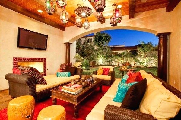 Open Moroccan Themed Living Room With A Lot Of Lamps