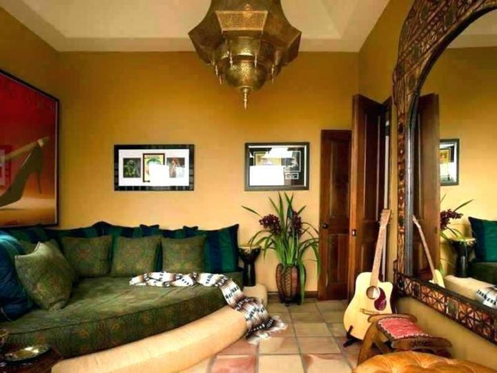 A Large Oriental Hanging Lamp and A  Large Framed Mirror Creating the Moroccan Theme of the Room