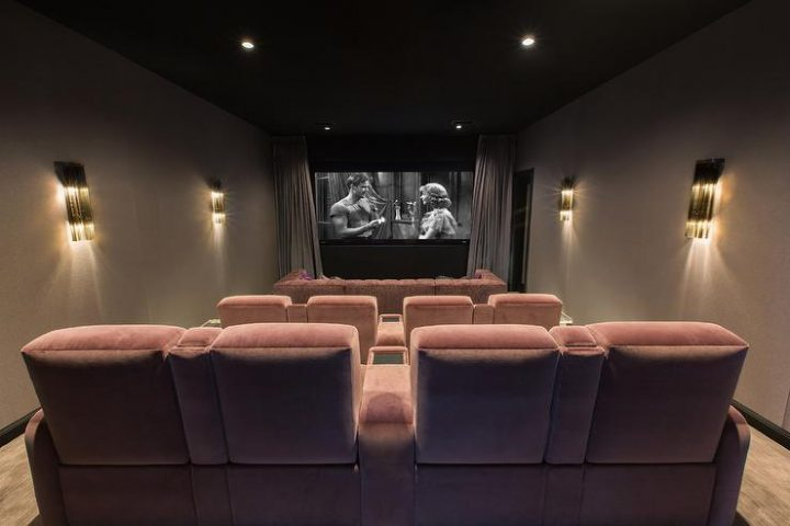 Art Deco Style Movie Room with Light Pink Velvet Seating