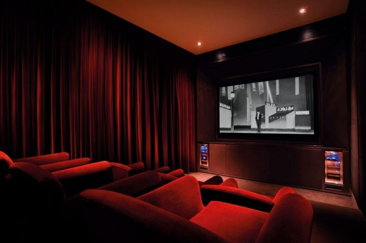 Small Movie Room Done Up Completely in Red Velvet