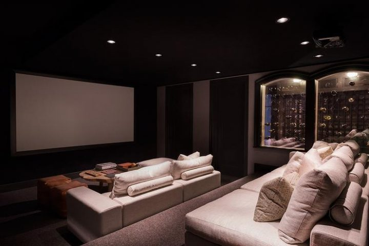 Luxurious Movie Room with Impressive Wine Cabinet