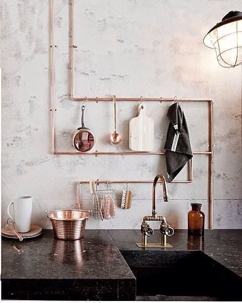 Exposed Pipes used as Hanger in Kitchen