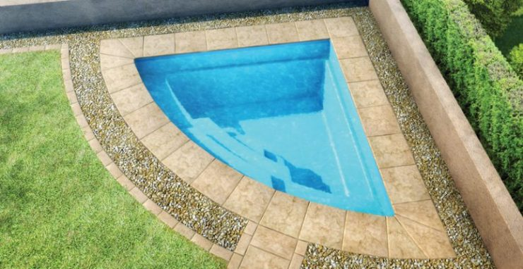 Cake-Slize Shaped Plunge Pool Tucked Into the Corner of the Garden