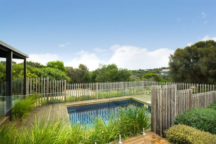 Plunge Pool With Wooden Deck and a Plant Fencing