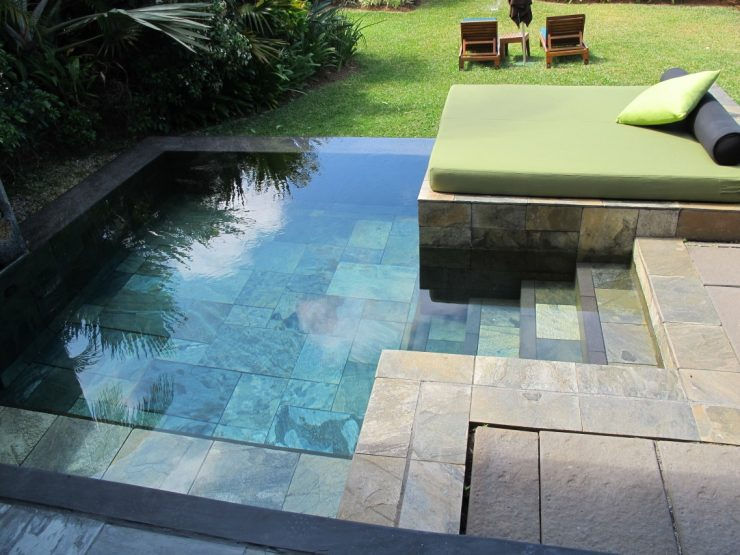 Stone-Tiled Plunge Pool With Sun Lounging Area