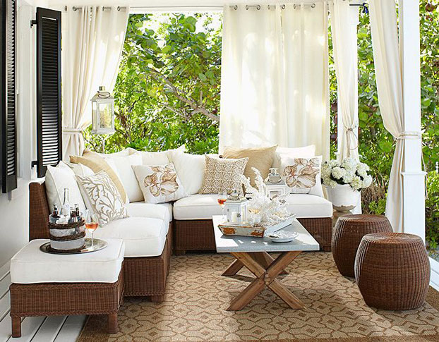Porch with Comfortable Seating Area Shaded With White Curtains